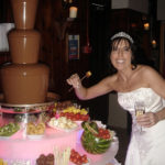 Bride with chocolate fountain –great addition to a wedding reception