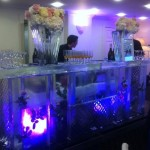3m curved ice bar with flowers and vases