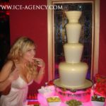White Chocolate Fountain with Woman Eating Strawberry | Ice Agency