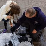 Surrey Christmas Market Live Ice Sculpture Carving Display in Kingston